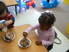 Toddlers making mud pies at Children's Palace